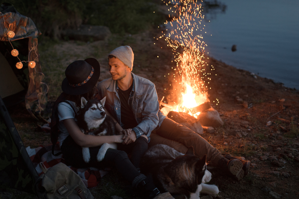 Couple Camping with a Dog